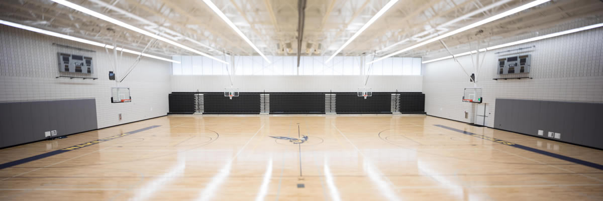 The gymnasium is a full-size basketball and recreational court with ample perimeter space.  Courses utilizing the gymnasium are Fitness and Wellness, Basketball, Circuit Training, Aerobics, and Fitness Testing.
