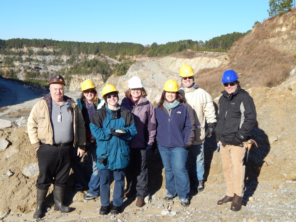 Geologists Dr. Ken Howard, Dr. Sara Rutzky, Gretchen Miller, Stephanie Rollins, Joseph Davis, and Tyler Clark pose at the Garner quarry while on a trip to select boulders in January 2014.