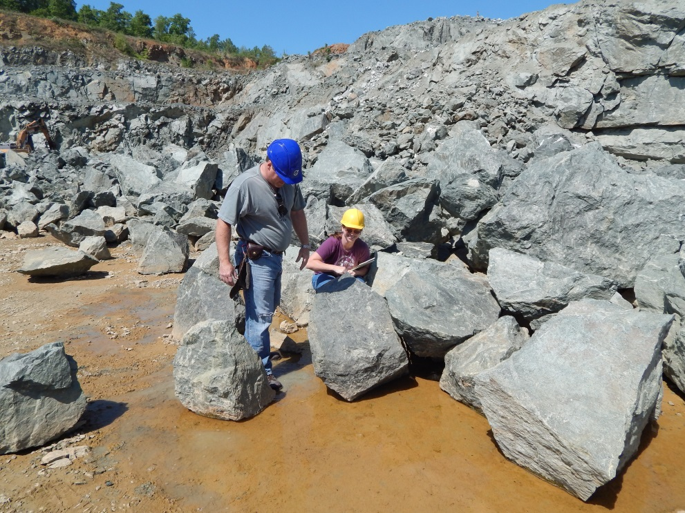 Figure 5: Geologists Tyler Clark and Dr. Sara Rutzky examine a group of boulders to see if appropriate for the OGL.