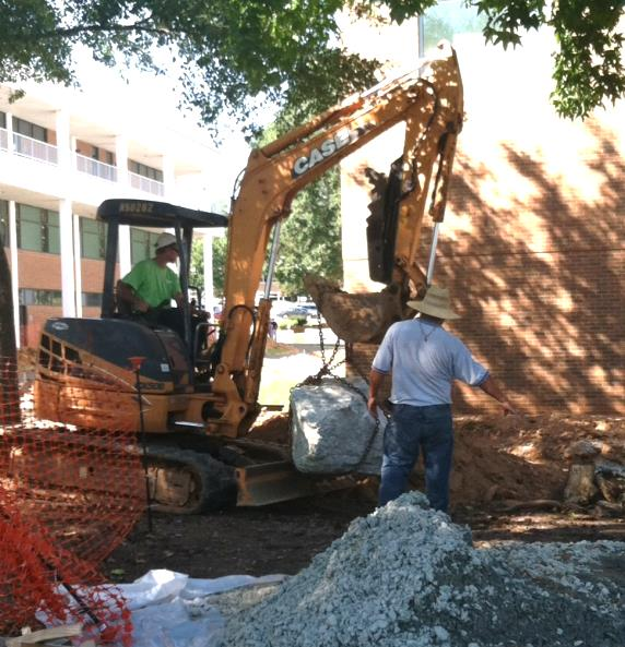 Figure 9: At Southern Wake (Main) Campus, rocks are unloaded and placed in the OGL using an excavator.