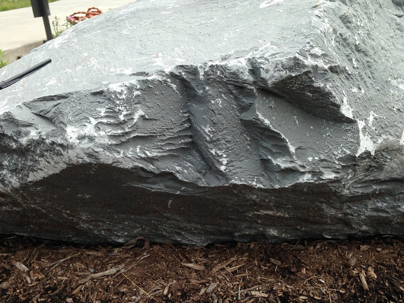 Figure 5: This image shows the edge of the meta-tuff boulder, showing the foliation layers revealed there.