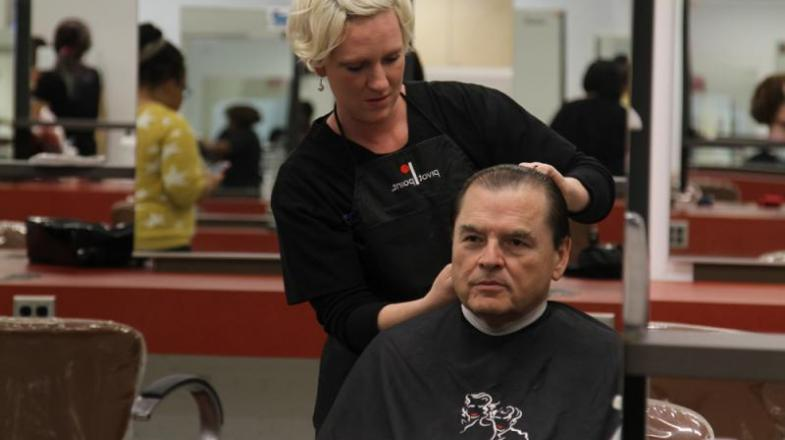 President Dr. Stephen Scott joined members of the Student Government Association getting haircuts in the college Cosmetology Salon.
