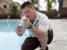 Pool Operator checking pH levels